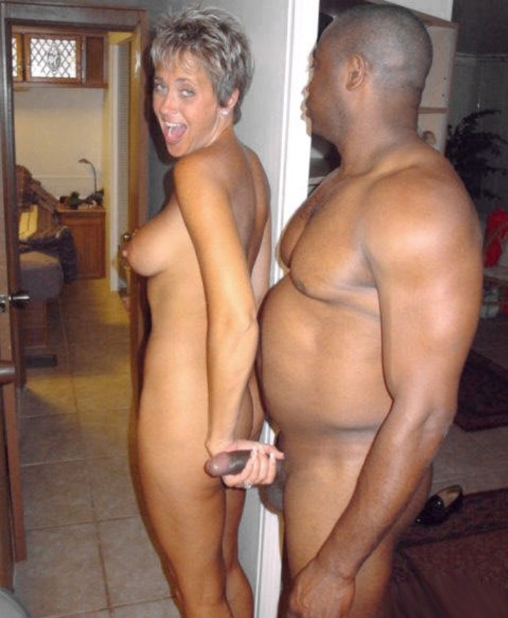 Smiling Mature Woman Grabs Black Dick with Her Hand